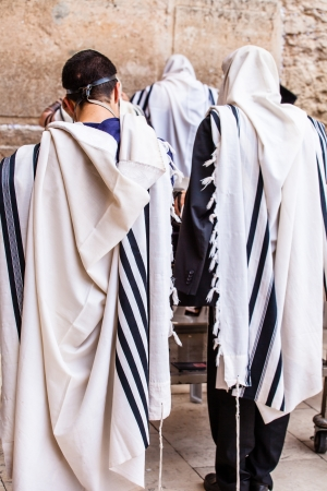 kippah: Jews praying at the Western Wall - Jerusalem.
