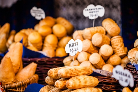 mount price: Traditional polish smoked cheese oscypek on outdoor market in Krakow, Poland.