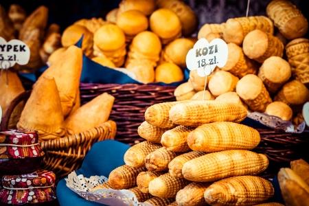 oscypek: Traditional polish smoked cheese oscypek on outdoor market in Krakow, Poland.