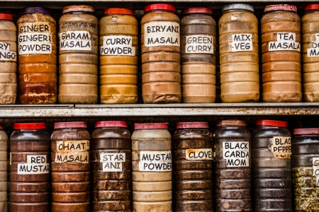 Jars of herbs and powders in a indian spice shop. photo