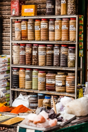 Jars of herbs and powders in a indian spice shop.