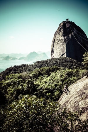 Brazil, Rio de Janeiro, Sugar Loaf Mountain - Pao de Acucar and cable car with the bay and Atlantic Ocean in the background.  photo
