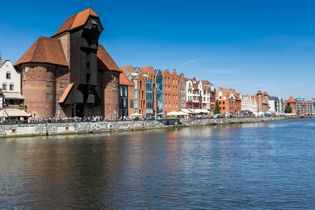 surviving: GDANSK, POLAND - 07 AUGUST: The medieval port crane over Motlawa river on 07 august 2014. This port crane built between 1442 and 1444 is the symbol of Gdansk and the oldest surviving port crane in Europe.