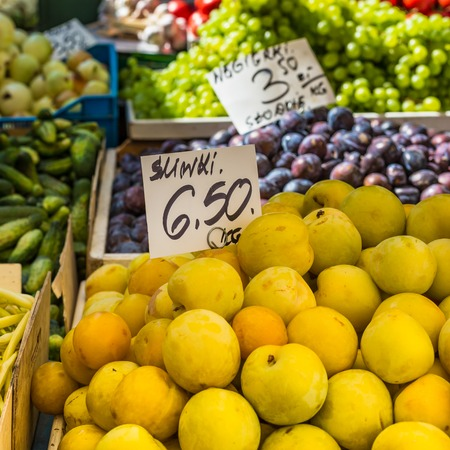 soft sell: Plums on the market stand in Poland.  Stock Photo