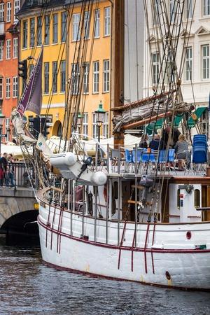 scandinavian peninsula: COPENHAGEN: Yacht in Copenhagen sea front in summer. Nyhavn is old waterfront and canal district