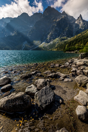 mnich: Green water mountain lake Morskie Oko, Tatra Mountains, Poland Stock Photo