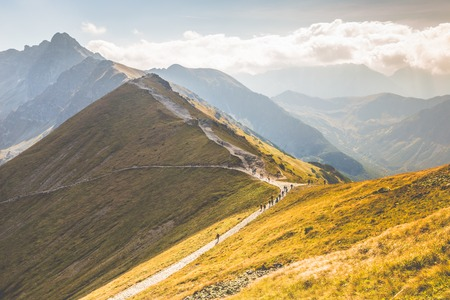 mountainscape: Path on the steep side of Kasprowy Wierch in Tatra mountains and a view of the border between Poland and Slovakia.