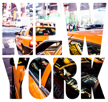 Yellow cab speeds through Times Square in New York, NY, USA. photo