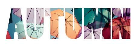 Word AUTUMN Background colorful umbrella photo