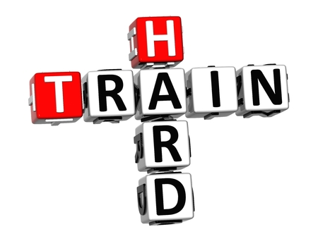 ironic: 3D Crossword Train Hard on white background Stock Photo