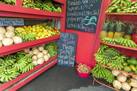 roadside stand: Pineapples and other fruits for sale at a roadside stand on Maui Hawaii