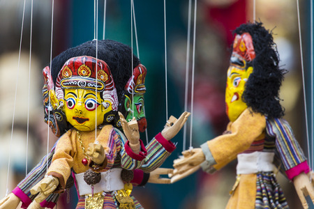 Masks, dolls and souvenirs in street shop at Durbar Square in Kathmandu, Nepal. photo