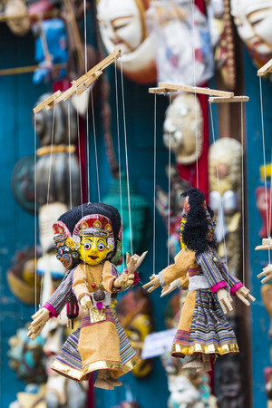 souvenirs: Masks, dolls and souvenirs in street shop at Durbar Square in Kathmandu, Nepal. Stock Photo