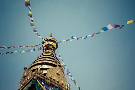 shankar: Buddha eyes close up with prayer flags at Bodhnath stupa in Kathmandu valley, Nepal