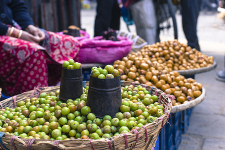 street vendor: The street vendor sels his fruits and vegetables in Thamel in Kathmandu, Nepal.