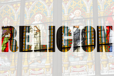 balthazar: Word RELIGION over stained glass church window
