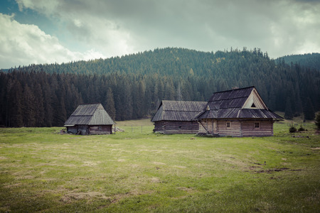 sheep road sign: Wooden hut in Chocholowska valley, Tatra Mountains, Poland