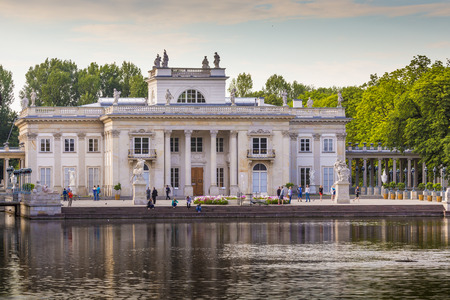 literally: WARSAW, POLAND - JULY 08, 2015: The Lazienki palace in Lazienki Park, literally Baths Park or Royal Baths; often rendered Royal Baths Park- largest park in Warsaw