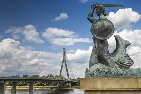 The Warsaw Mermaid called Syrenka on the Vistula River bank in Warsaw, Poland