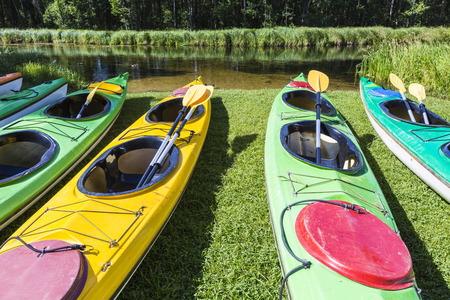 fiberglass: Colorful fiberglass kayaks tethered to a dock as seen from above