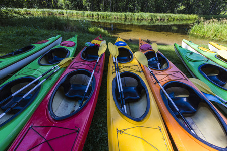 tether: Colorful fiberglass kayaks tethered to a dock as seen from above