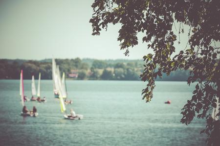 masuria: Yacht in the background,Goldopiwo lake, Masuria, Poland.