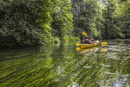 Kayaking on the Rospuda river, Poland Stock Photo