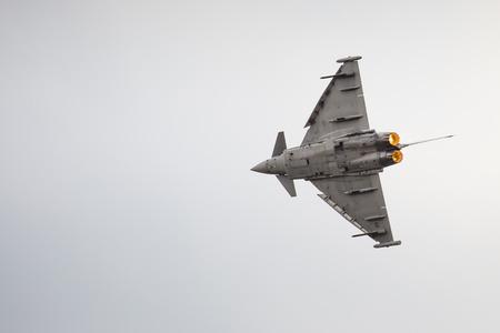 aerobatic: RADOM, POLAND - AUGUST 23: Italian EFA-2000 Eurofighter Typhoon demo display team during Air Show 2015 event on August 23, 2015 in Radom, Poland Editorial