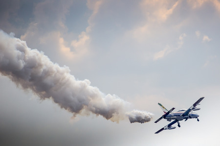 flight mode: RADOM, POLAND - AUGUST 23: Aerobatic group formation Frecce Tricolori italian aerobatic Team at blue sky during Air Show Radom 2015 event on August 23, 2015 in Radom, Poland