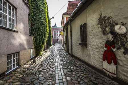 Narrow medieval street in old city of Riga, Latvia.