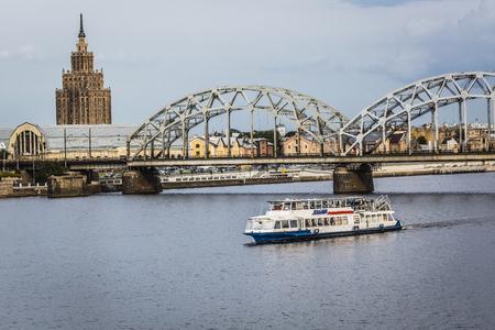 riga: Railway Bridge and River Daugava, Riga, Latvia Editorial