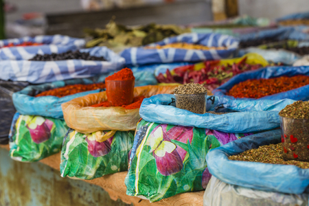 bazar: Beautiful vivid oriental market with bags full of various spices in Osh Kyrgyzstan.