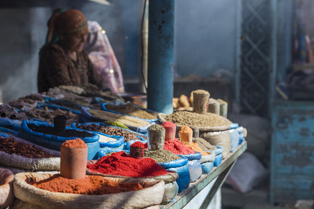 saffron: Beautiful vivid oriental market with bags full of various spices in Osh Kyrgyzstan.