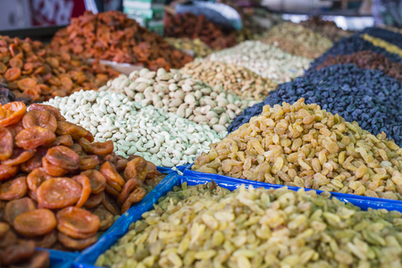 frutas secas: Dry fruits and spices like cashews, raisins, cloves, anise, etc. on display for sale in a Osh bazaar in Bishkek Kyrgyzstan.
