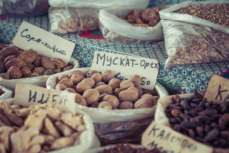 safran: Beautiful vivid oriental market with bags full of various spices in Osh Kyrgyzstan.