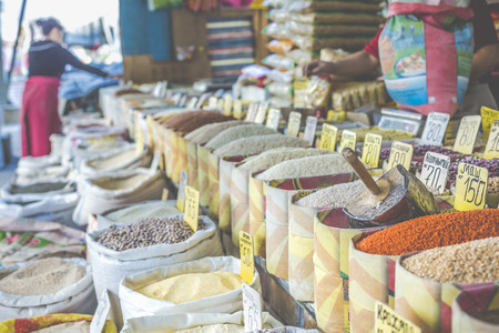 Vivid oriental central asian market with bags full of various spices in Osh bazar in Bishkek, Kyrgyzstan. Stock Photo