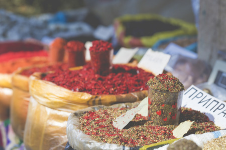 bazar: Vivid oriental central asian market with bags full of various spices in Osh bazar in Bishkek, Kyrgyzstan. Stock Photo
