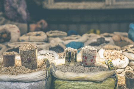 safran: Vivid oriental central asian market with bags full of various spices in Osh bazar in Bishkek, Kyrgyzstan. Stock Photo