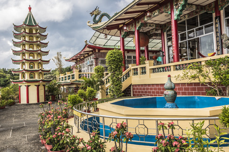 temple: Pagoda and dragon sculpture of the Taoist Temple in Cebu, Philippines. Stock Photo
