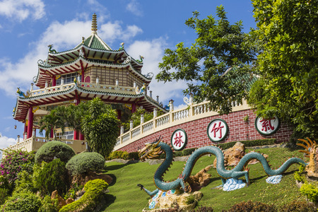 chinese pagoda: Pagoda and dragon sculpture of the Taoist Temple in Cebu, Philippines. Stock Photo