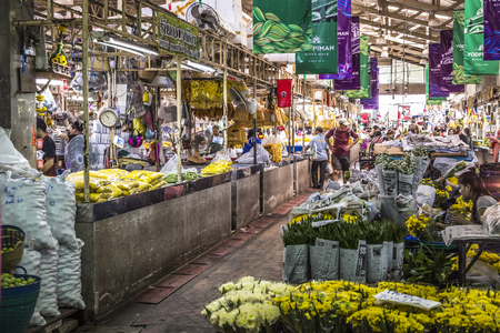 malai: BANGKOK, THAILAND - NOVEMBER 07, 2015: Local woman sells Thai style garland (Phuang Malai) at a market near Silom road, Bangkok, Thailand