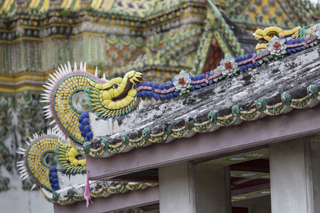 buddhist temple roof: Wat Pho known also as the Temple of the Reclining Buddha is a royal temple of the first grade, one of ten such temples in Bangkok and 23 in Thailand Stock Photo