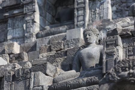 stoned: Stoned image of Buddha in Borobudur, Indonesia Stock Photo