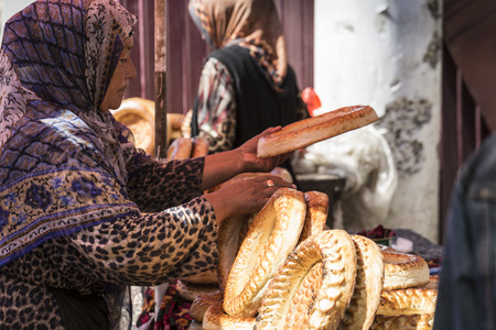 Kirghiz bread tokoch on Sunday market in Osh. Kyrgyzstan.