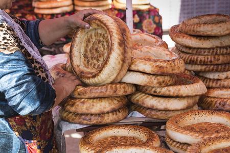 pastil: Kirghiz bread tokoch on Sunday market in Osh. Kyrgyzstan.