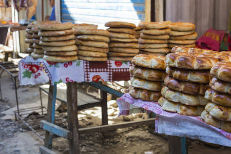sunday market: Kirghiz bread tokoch on Sunday market in Osh. Kyrgyzstan.