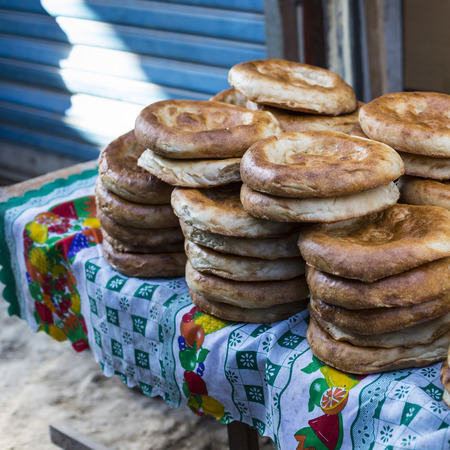 troche: Kirghiz bread tokoch on Sunday market in Osh. Kyrgyzstan.
