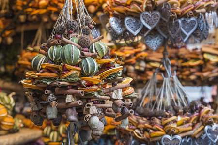 bounded: Christmas decorations made with dried fruits. Christmas garland, chaplet to decorate christmas tree. Home-made decorations sold during Christmas market. Stock Photo