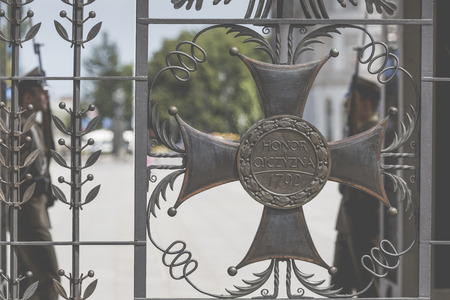 tomb of the unknown soldier: WARSAW, POLAND - JULY, 08: The Tomb of the Unknown Soldier at Pilsudski Square, on July 08, 2015. Tomb of the Unknown with eternal flame, since 1925. Editorial