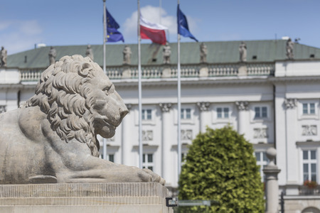 municipal editorial: WARSAW, POLAND - JULY 09, 2015: Lion and Prince Jozef Poniatowski statue seen in the distance, by Danish sculptor Bertel Thorvaldsen, in front of the courtyard of the Presidential Palace Editorial